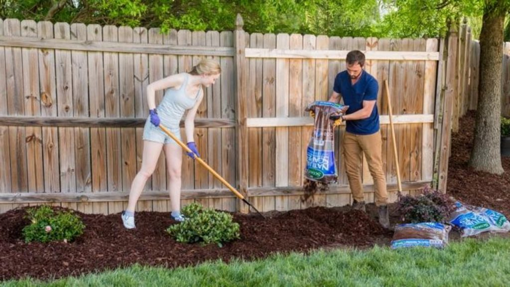 throwing mulch in the lawn